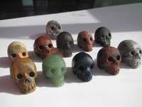 Wholesale 11 natural colorful carved quartz crystal skull healing without polishing