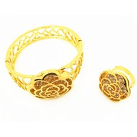 Wholesale New fashion imitation gilt lotus shaped tin alloy exotic style bracelets golden or ring sets for Women