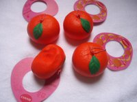 Wholesale in a small box very slow rising orange squishy with tags