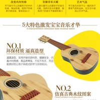 Wholesale Children can play guitar ukulele music instrument simulation toys Mini Baby Beginners small guitar