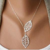 achat en gros de laisser collier en or-La nouvelle mode des feuilles creuses d'or laisse des bijoux de charme féminin, collier en or collier chaîne clavicule collier