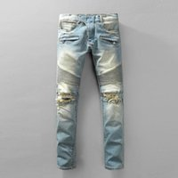 america jeans - Balmain brand motorcycle models in Europe and America to do the old hole in jeans washing mill yellow Slim jeans feet tide