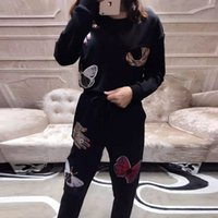 Wholesale black sequined butterflies spangled tinseled hands sweatshirt top ankle length pants fashion tracksuit autumn womens