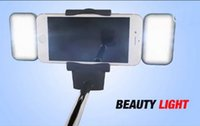 Wholesale Automated Extension Selfie Stick with Flash Light fan