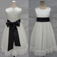 al por mayor ajuste joya-La vendimia florece blanco y negro de la muchacha se viste una línea joya sin mangas de las perlas que el arco del marco jadea el vestido formal con el ajuste del cordón