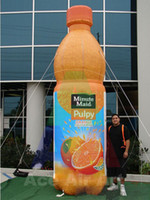 balloon juice - orange giant bottle advertising for Minute Maid inflatable fruit juice bottle with free air blower