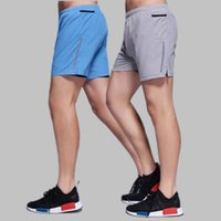 Wholesale Sports pants male new woven two piece tight leisure five point pants professional stretch quick drying fitness pants