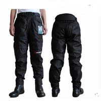 Wholesale Top quality motorcycle pants DUHAN DK002 motocross racing pants red blue black with knee guards windproof pants M L XL XXL