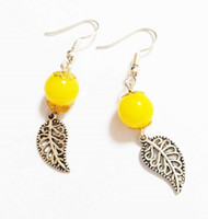 Wholesale 2016 fashion popular yellow crystal earrings for women with low as present