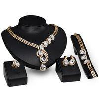 Vente chaude de femme de mariage de mode de concepteur de diamant de mode de diamant collier en or Collier boucle d'oreille bracelet anneau 4 pcs bijoux ensemble