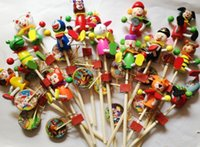 Wholesale Wood shook his turn puppet doll animal cartoon hand drum manufacturers children s toys spread the temple