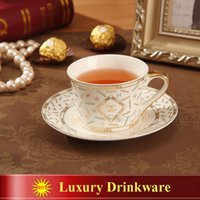 Wholesale Porcelain tea cup and saucer luxury outline in gold bone china coffee cup set high end drinkware saucer set cups and saucers