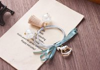 band of horses - 2016 new Korean version of fast delivery of new products can be customized alloy shook his horse bow hair rubber band circle tassel jewelry
