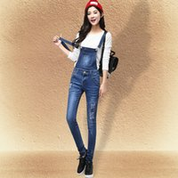 Wholesale Spring girl braces jeans stretch feet pencil pants hole detachable sling conjoined leisure pants
