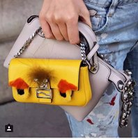 Wholesale Fashion personality little monsters pu material clutch bag New Handbag bag shopping monster leather