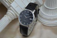 Mode en cuir véritable bracelet masculin et féminin Simple Haut renforcé le visage en verre brun noir Quartz mécanique entièrement automatique 61002