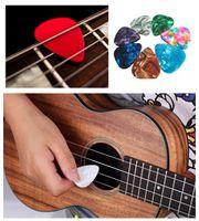 Wholesale 100 Celluloid Ukulele Guitar Picks Antiskid Finger Plectrums Paddles Stringed Instruments Guitar Parts Accessories Mixed Random Col
