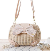 Wholesale Factory direct summer new high end lace bow and straw bag retro casual beach bag woven cartoon handbags women trend