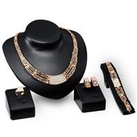 Wholesale China Hot Selling Ethnic Jewelry Set Gold Plated CZ Diomand Pendant Bracelet Earrings Ring Set Women Luxury Jewelry