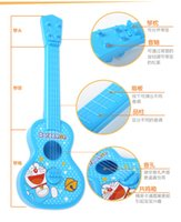 Wholesale Doraemon guitar toys for children Simulation of small guitar music toys Can play an instrument