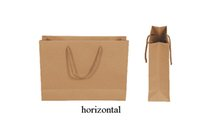 Cheap horizontal 10 sizes stock and customized kraft paper ivory board black paper gift bag paper bag with rope handles ELB156