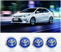 Wholesale 4 x Newest Luminous Toyota Car Wheel Center Covers LED Wheel Cap Lights With Non Rotating Emblem No Battery Powered By Driving Speed