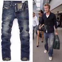 beckham jeans - High Quanlity men famous brand blue denim designer high quality ripped jeans for men classic retro David Beckham same paragraph