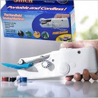 venda por atacado stitching machine-2016 Handy ponto Handheld Elétrica Máquina de costura mini portáteis sem fio Travel Home Retail Packing