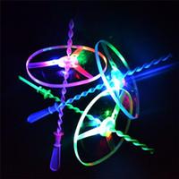 Wholesale LED Amazing flying toys Hand Pushing LED Flash Bamboo Dragonfly flying Helicopter Disc with three LED lights