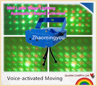Wholesale 4 In One Red Green mini Voice activated Moving Projector Disco DJ Stage Xmas Party Show Club Laser Lighting Light With Tripod
