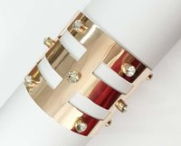 american cut glass - metallic cut out open cuff bracelet with clear glass stones etched geometric shape rose gold plated