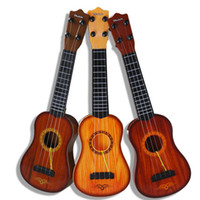 Wholesale Children s toys can play the ukulele Mini Guitar simulation instrument baby small guitar music and it