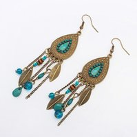 Wholesale New hot Retro bohemian oval leaves tassel earrings European and American fashion beads earrings