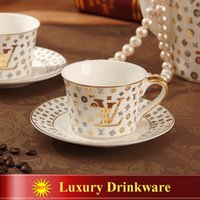 Wholesale Porcelain tea cup and saucer luxury outline in gold bone china coffee cup set high end coffee cup saucer set cups and saucers