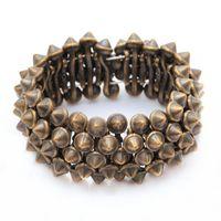 achat en gros de pic rivets argent-Gothique Punk Rock Studs Spike Rivets Shaped Stretch Bracelets Pour Femmes Argent / Nickel / Bronze Pour Le Choix