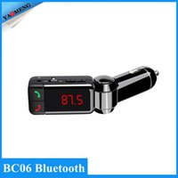 Wholesale New Portable Dual USB Auto Bluetooth Car Kit Wireless Hands Free Calling MP3 Player FM Transmitter Modulator Car Charger