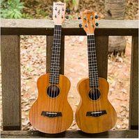 Wholesale High cost of high quality guitar Andrew inch inch ukulele ukulele Hawaiian ukulele small four string guitar