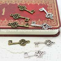 100pcs / lot Deux couleurs 28 * 12mm nouvelle couronne pendentif en alliage matériel de bricolage pendentif clé charmes clés accessoires bijoux boutique gros 1881