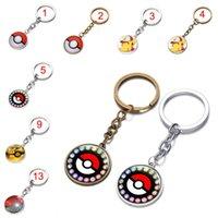 Wholesale 16 colors Poke ball keychain Pocket Monsters Pikachu Eevee Charizard time gemstone glass key chain key rings bag pendants cheap