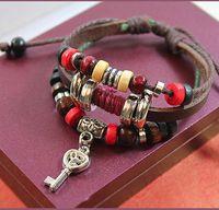beaded key chains - Vintage fashion woven leather bracelet bracelet pure hand rivet design key three genuine leather unlimited charm fashion jewelry