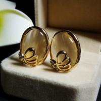 al por mayor joyería de ópalo simulada-Pendientes del ojo del marco del tono simulada White Opal Oval Pendientes de plata florales Crystal Gatos clúster para sus joyas de regalo