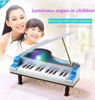 Wholesale The latest development of children s piano music toy multifunctional musical instrument keyboard D lights to play music songs