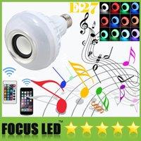al por mayor iphone luz led remoto-LED RGB del color de los bulbos de altavoces Se iluminan las lámparas 16 colores se adaptan a distancia inteligente de control de música del altavoz de audio del altavoz E27 hilos de Bluetooth para iPhone