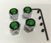 Cheap 4pcs set the cute ET green face pattern Metal Anti-theft Style Car Wheel Tire Valves Tyre Dust Caps for all car