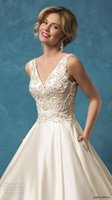 adorn covers - Noemis sleeveless V neck bodice adorned with crystals and pearl beading sweep train bridal gowns