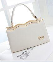 Wholesale The new female bag shoulder bag cross grain bowknot handbag fashion lady one shoulder bag PU leather bag
