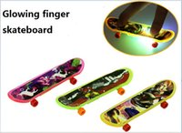 Wholesale Glowing Finger Skateboards LED Toys Patterns Mixed Professional Kid s Toys Mini Finger Board Fingerboard Education Toys Random Types