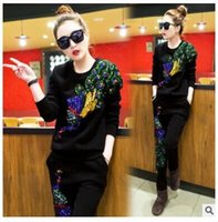 Wholesale European Grand Prix spring new casual pants suit female phoenix pattern sequined two piece sweater