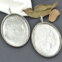 Wholesale Vintage tibetan silver oval charms cabochon metal pendants fit diy necklace jewelry sentting