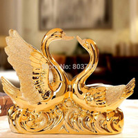 Wholesale Creative wedding gift ceramic gold swans living room ornaments crafts home decorations